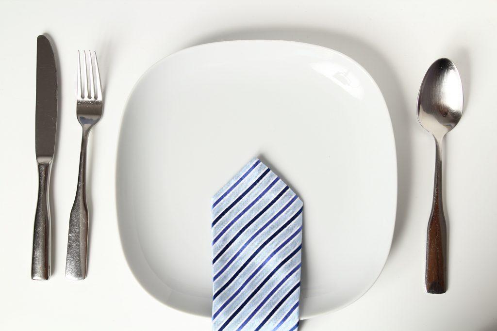 tie on dinner plate